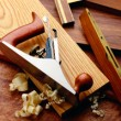woodworking tools on reddish wood