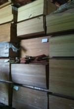 plywood stacked in lumberyard building
