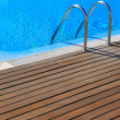 wood deck by inground pool
