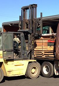 Forklift loading lumber at J Gibson McIlvain