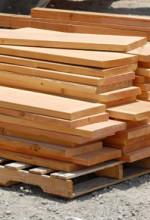 fresh cut wood boards pile