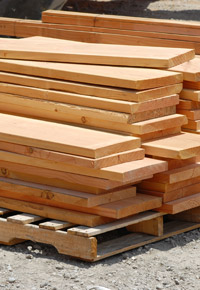 fresh cut wood boards pile