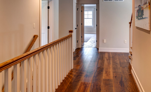 hallway with rehmeyer wood flooring