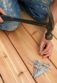 hammering nails into wood deck
