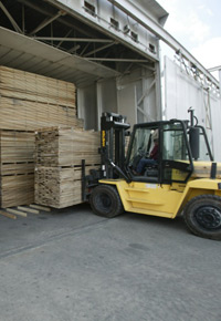 Loading a kiln with lumber to dry