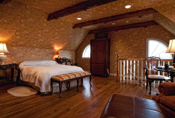 Contemporary bedroom with Rehmeyer Hardwood Flooring